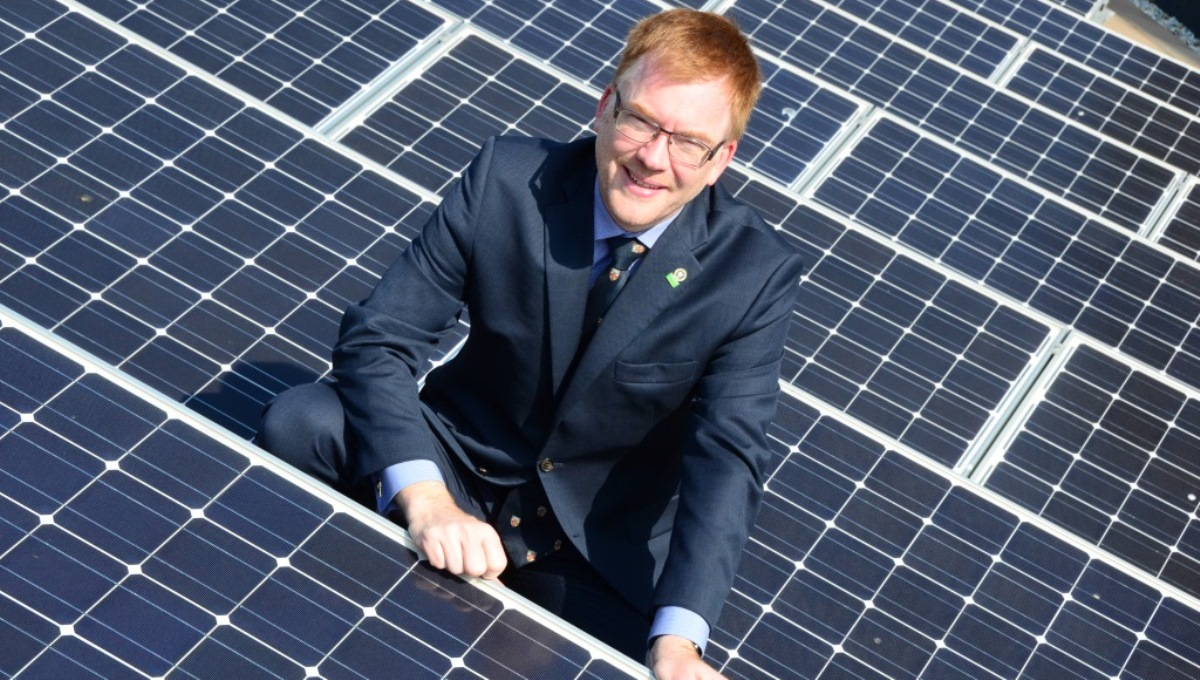 Cllr Warren Whyte with solar panels on County Hall roof