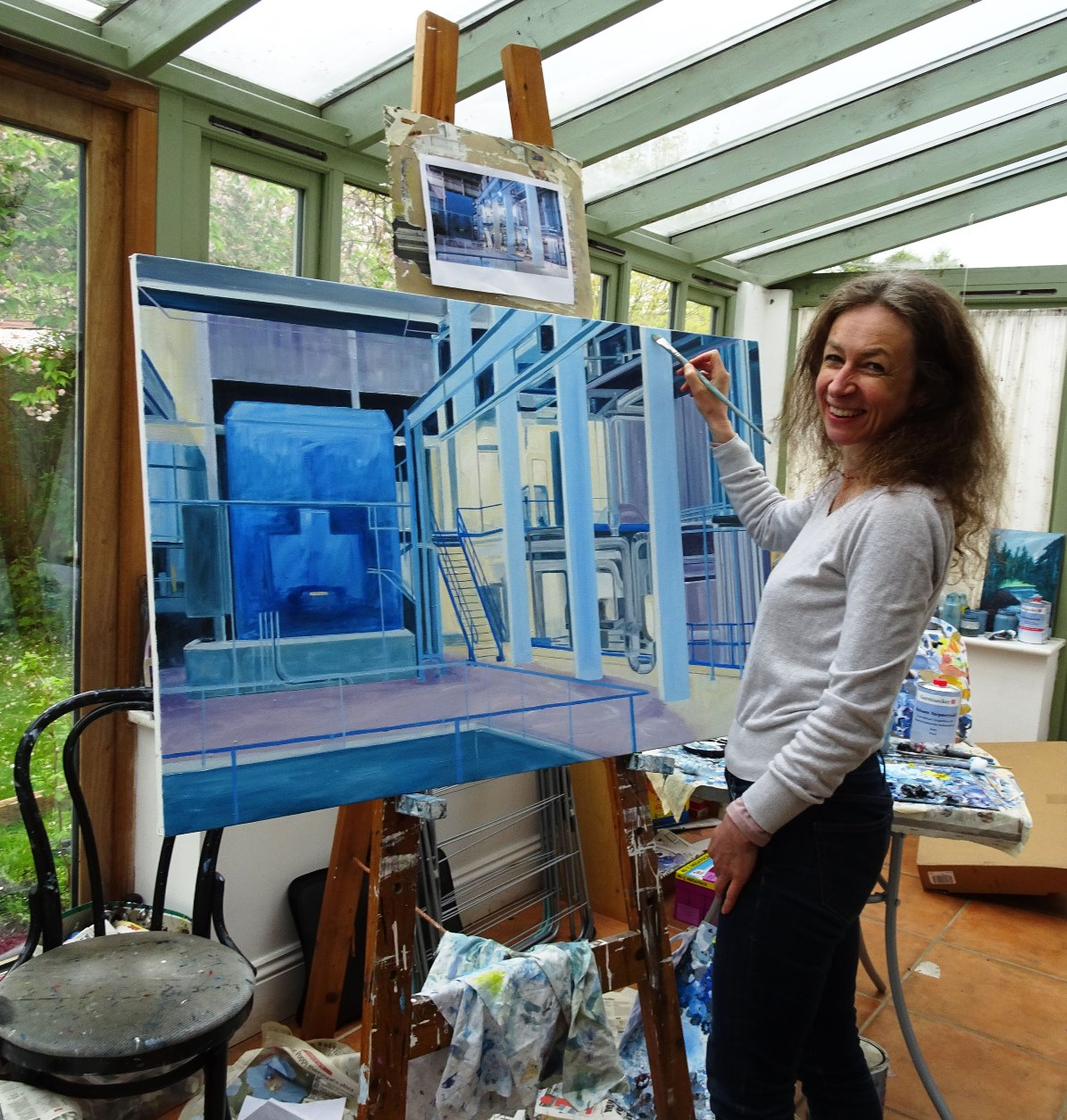 Sarah Moncrieff at work in her studio, putting the finishing touches to her painting of the Greatmoor turbine hall